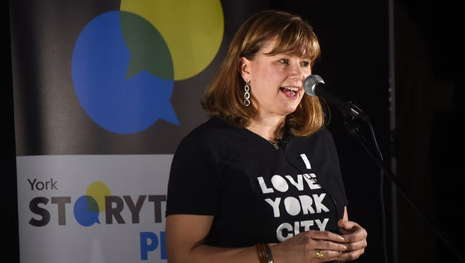 Debbie Bailey shares her story with the audience during the York Storytellers: #ILoveYorkCity event at Central Market on Tuesday, Feb. 6, 2018.