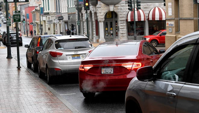 A car backs into a parking spot as the motorist parallel parks on West Beverley Street in downtown Staunton.