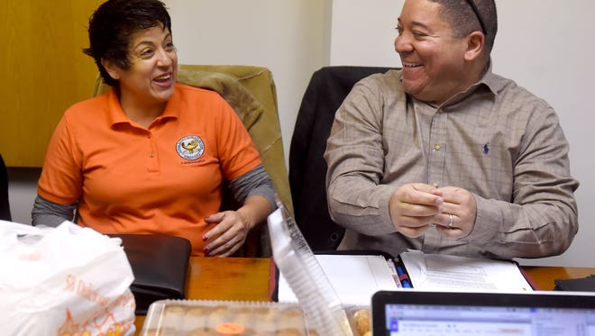 Before the start of the meeting of the organization Latinos Unidos of York, members Elodia Barajas, left, and Lou Rivera share a moment. 
