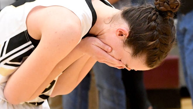 Buffalo Gap's Leah Calhoun is overcome with emotion after they win over George Mason in a VHSL Class 2 girls state basketball semifinal game played in Stuarts Draft on Tuesday, March 6, 2018. Gap advances to the Class 2 girls state championship in Richmond on Friday.