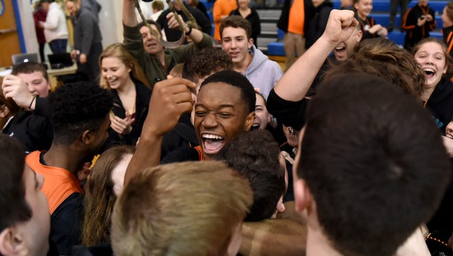 The Northeastern basketball team and the fans celebrate following the Bobcats' 63-60 comeback victory over Penncrest in the second round of PIAA 5A action at Garden Spot High School on Tuesday, March 13, 2018.