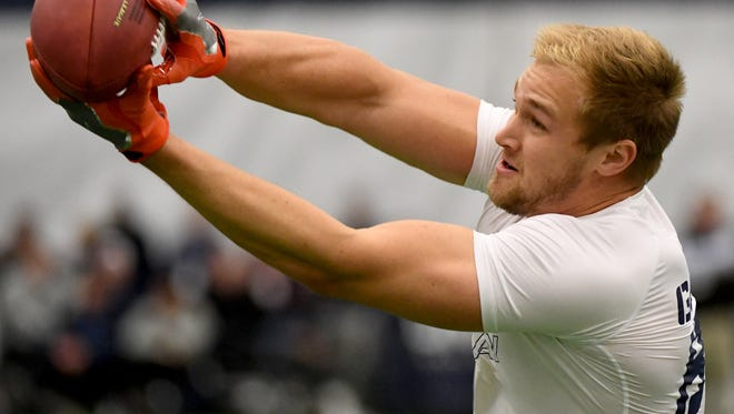 Former Penn State player Mike Gesicki ran practice pass routes during the Penn State Football Pro Day at State College on Saturday, March 20, 2018.