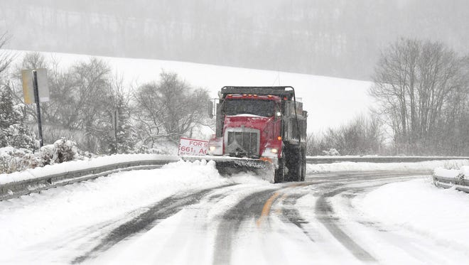 A snowplow clears Barterbrook Road during a spring snow storm on Wednesday, March 21, 2018.