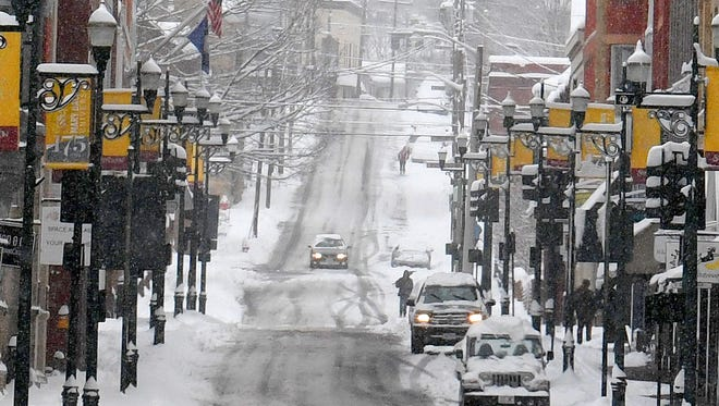 Looking down Beverley Street during a spring snow storm on Wednesday, March 21, 2018.