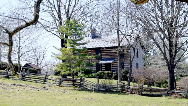 View of the1820s log cabin at Forest Hill Farm from Arborhill Road.