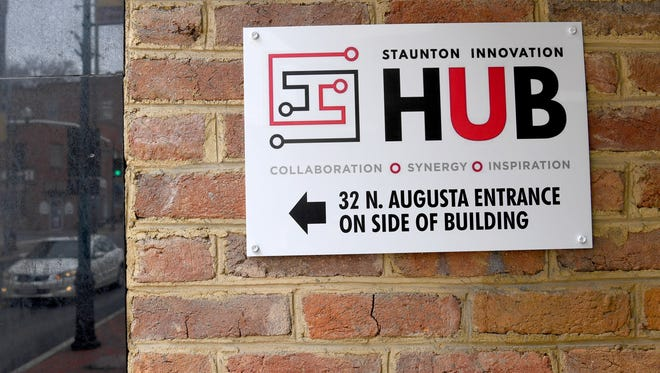 A sign on the building points the way to the entrance for the 32 North Augusta location of Staunton Innovation Hub on Wednesday, April 25, 2018.