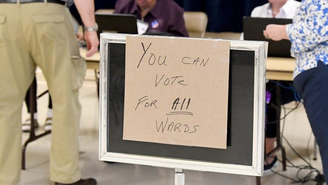 A sign lets voters know they can vote for candidates representing all the voting wards at the Ward D polling place in Waynesboro on Tuesday, May 1, 2018.