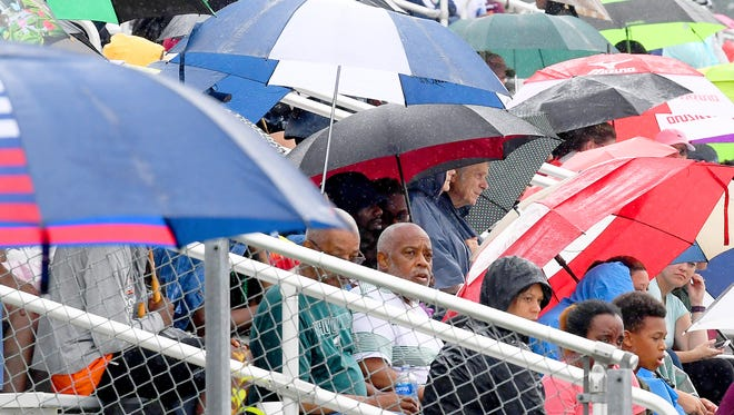 Umbrellas are everywhere as they are used by athletes and fans to protect them from the rain during the Group 3A state track and field championships held in Harrisonburg on Saturday, June 2, 2018.