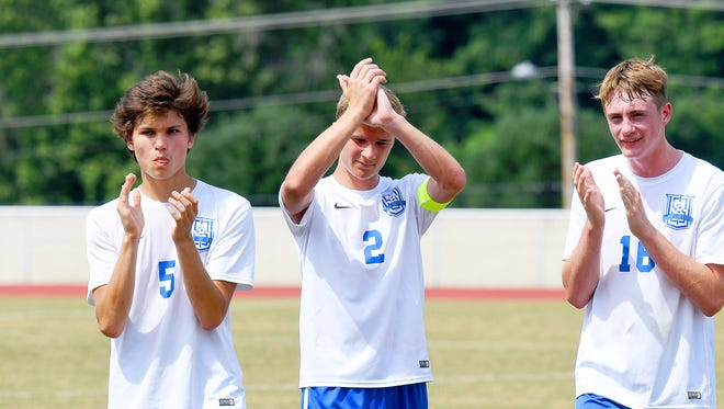 Robert E. Lee's Isaiah Knopp, Luke Gaines and Carter Koehn applaud their fans who applaud them after the lose to George Mason in their Class 2A state boys soccer semifinal game played in Radford on Friday, June 8, 2018.