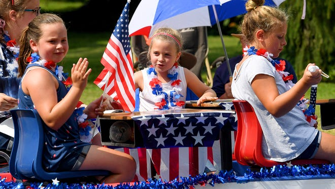 Young parade goers share a float as they travel the parade route. The Happy Birthday America Parade made its way through Gypsy Hill Park in Staunton on Wednesday, July 4, 2018.