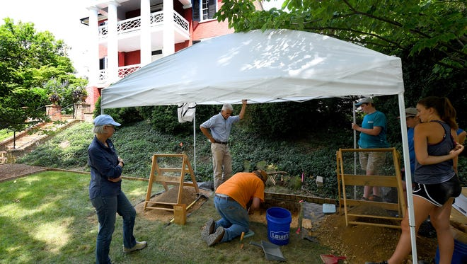 Volunteers join Dennis Blanton, an associate professor of anthropology with James Madison University, with conducting a two week long archaeological assessment at the Woodrow Wilson Presidential Library on Monday, July 16, 2018.