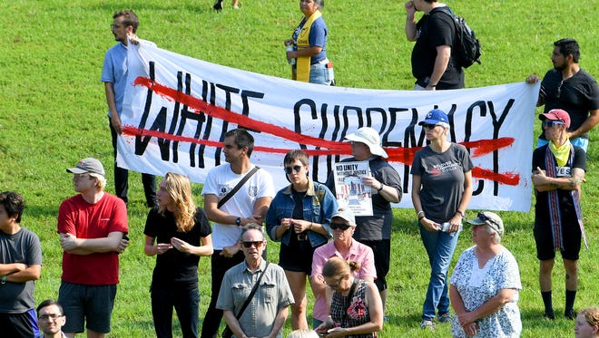 An anti white supremacy banner at a rally held at Booker T. Washington Park in Charlottesville, Va., on Sunday, August 12, 2018. The day marked the anniversary of the deadly protests last year.