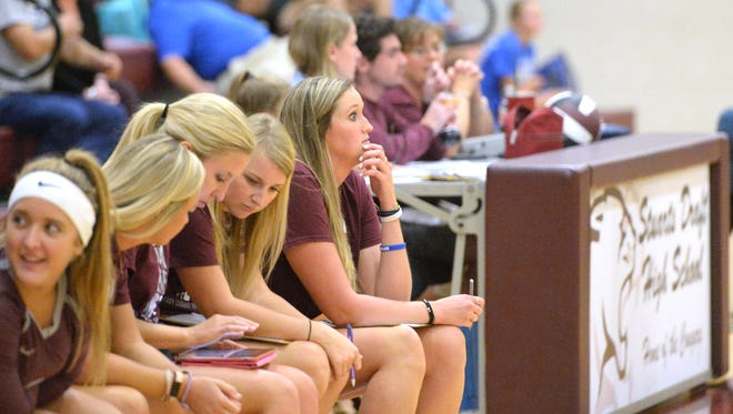 Kamron Johnson, end of the bench, was the junior varsity volleyball coach before taking over as varsity head coach this year at Stuarts Draft.