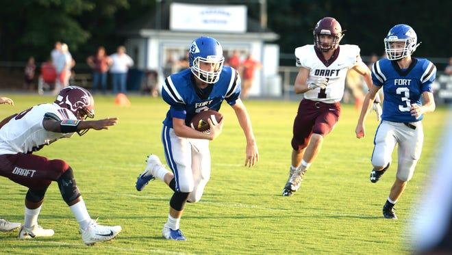 Fort Defiance quarterback Austin Monroe looks for some running room against Stuarts Draft Friday, Aug. 31.