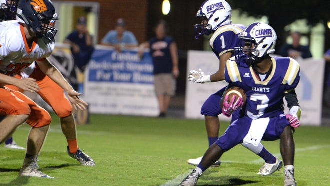 Waynesboro's Dayvon Young looks for some running room Thursday night against Clarke County.