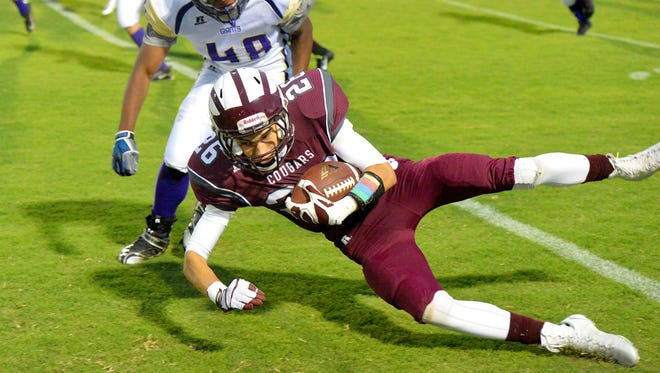 Stuarts Draft's Zachary Engleman goes down with Waynesboro's Tony Fitch behind him during the first half of a football game played in Stuarts Draft on Friday, Sept. 12, 2014.