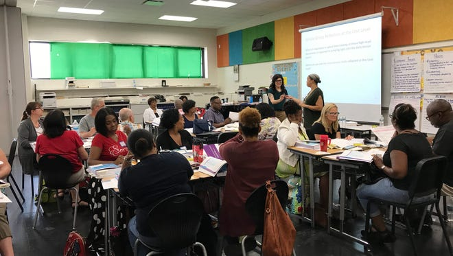 Teachers from Detroit Public Schools Community District attend training on the district's new curriculum in 2018.
