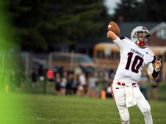 New Oxford quarterback Brayden Long loads up for a