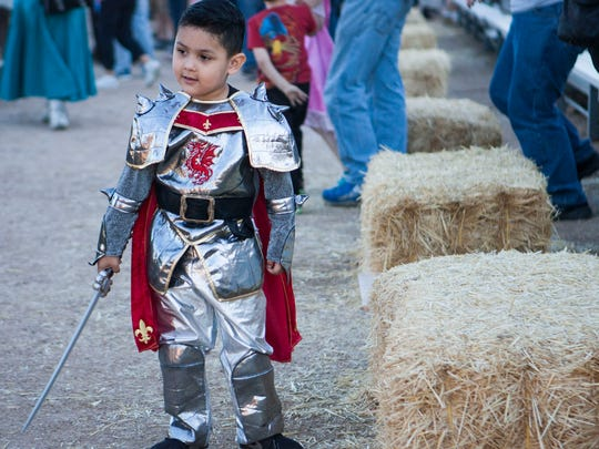 Isaiah Lovatos takes a break after watching the Joust