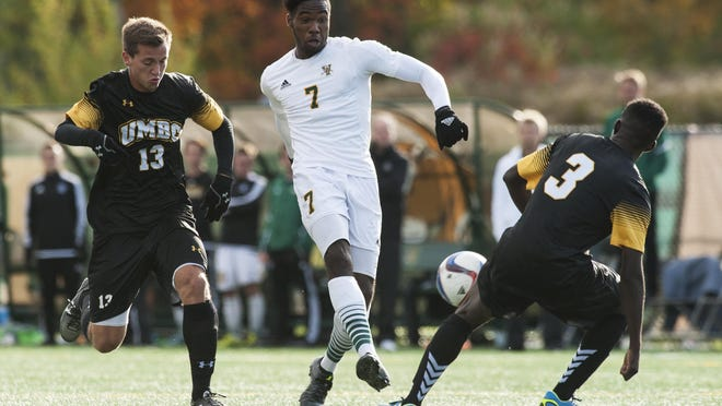 Vermont's Brian Wright (7) gets past UMBC's Gregg Hauck (13) and shoots the ball during a men's soccer game earlier this year at Virtue Field. Wright has a UVM-best 10 goals and seven assists.