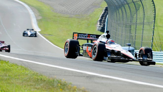 Will Power of Australia leads a group of race cars Sunday, July 4, 2010, on his way to winning the IndyCar Series' Watkins Glen Camping World Grand Prix at The Glen in Watkins Glen, N.Y. (AP Photo/Douglas Ford Rea)