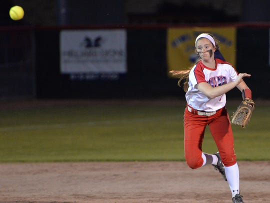 Oakland shortstop Reagan Bogle throws to first during