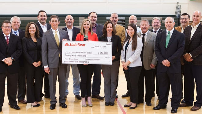 State Farm agents of southwest Missouri present a check for $25,000 to the staff of Missouri Safe and Sober to create a comprehensive program for teen drivers.