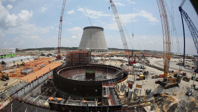 FILE- In this June 13, 2014 file photo, construction continues on a new nuclear reactor at Plant Vogtle power plant in Waynesboro, Ga. The delays in the nuclear industry are adding up, adding hundreds of millions of dollars to already expensive projects. The latest announcement came from SCANA Corp., which expects a year-long delay in the completion of its two reactors under construction in South Carolina. That announcement raised questions about whether an identical plant under construction by the same builders in Georgia will also see expensive delays.
