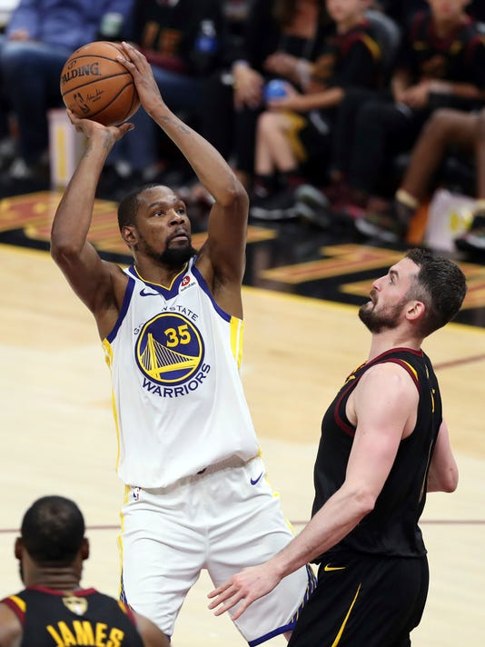 1b5cb2a066b8 NBA Finals Warriors Cavaliers Basketball 78170.jpg. Golden State Warriors   Kevin Durant shoots over Cleveland Cavaliers  Kevin Love during the ...