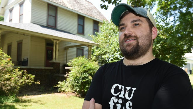 Dalton Coffey, of South Dakota, talks about his movie, Poor Mama's Boy, while standing in front of Harold Meyer's house in Yellville. Coffey, who grew up in Harrison, is shooting the movie at Meyer's home.