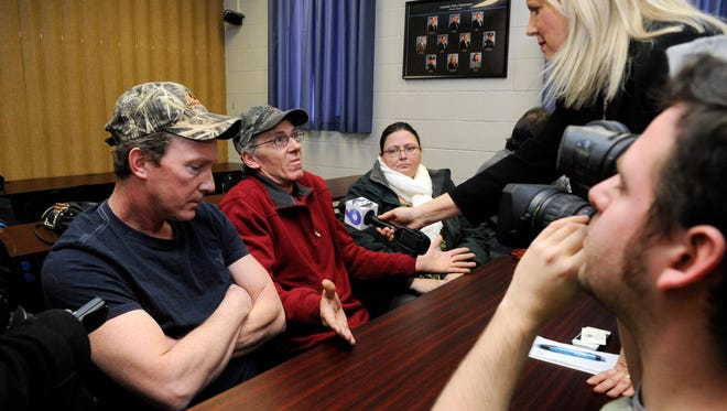 Kenny Green, Terri Hamm's brother, center, talks to reporters with Kevin Green, Hamm's other brother, and Nicki Green, Hamm's sister-in-law, after a news conference Wednesday morning at the Lancaster Police Department in downtown Lancaster.