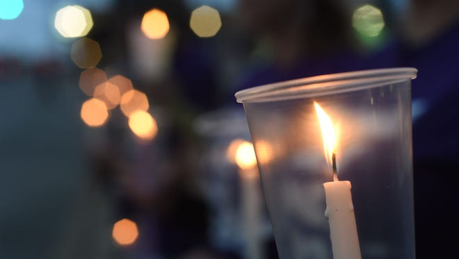 A group of 30 friends gathered for a candlelight vigil on the downtown square in Mountain Home to honor Raul Turrieta on Thursday night. The date marked the two-year anniversary of his murder.