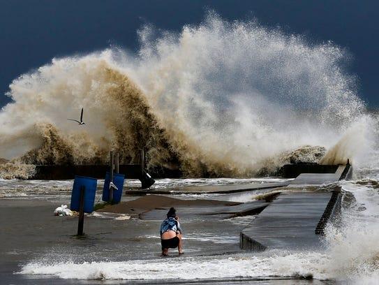 Sydney Schultz takes photos of waves crashing next