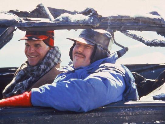 Steve Martin, left, and John Candy film a scene from