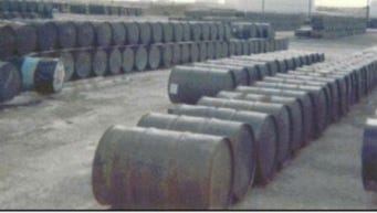 """A photo of a drum storage lot at Andersen Air Force Base in the Vietnam War era, which was later designated an EPA cleanup site. According to Edmison, this photo doesn't show barrels of Agent Orange. He thinks the photo does show barrels of other """"Agent Rainbow; chemicals."""