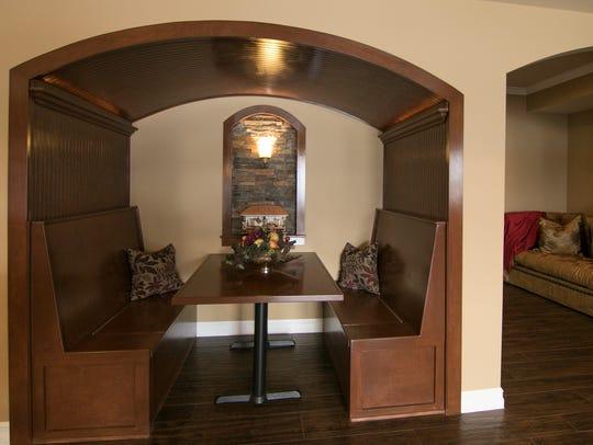 An inset dining area includes a brick decorative alcove