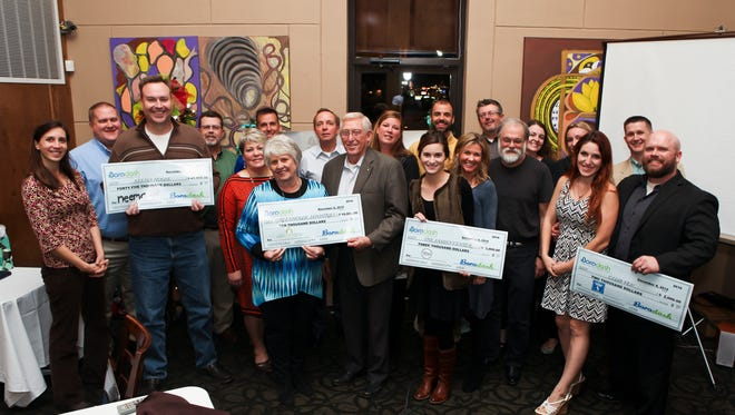 The 2015 Borodash Board and the charity recipients gather to celebrate the $60,000 generated bsy Thanksgiving Day race's proceeds.