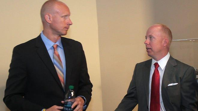 Xavier coach Chris Mack, left, and Cincinnati coach Mick Cronin.