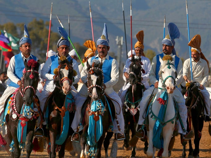 Pakistani riders wait their turn to compete in a tent