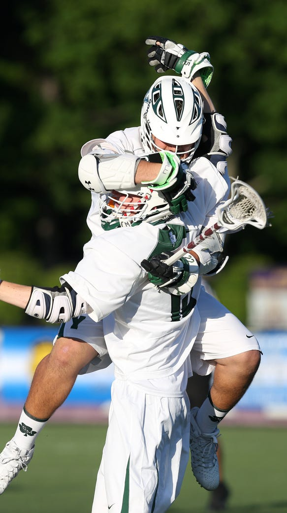 Yorktown's Steven Veteri jumps into the arms of teammate