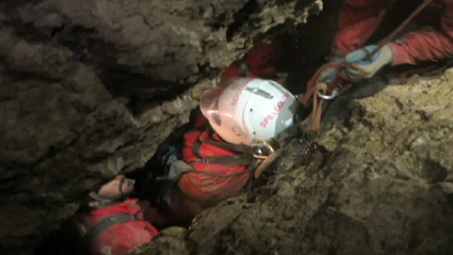 This screenshot from a video provided by the Bavarian Mountain Rescue Service on Tuesday June 17, 2014 shows rescuers transporting cave explorer Johann Westhauser in Riesending cave near Marktschellenberg near Berchtesgarden, Germany, Germany's mountain rescue service says it could complete the rescue of the injured cave researcher from the country's deepest cave on Thursday or Friday as experts make good progress through the labyrinth's passages and shafts. Johann Westhauser suffered head injuries nearly 1,000 meters (3,280 feet) underground in the Riesending cave system, in the Alps near the Austrian border, on June 8.