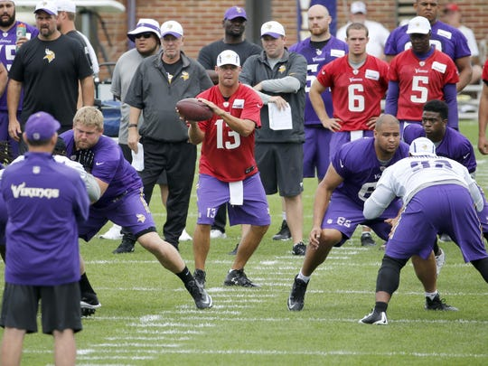 Minnesota Vikings quarterback Shaun Hill takes a snap from the shotgun formation during Tuesday's practice at an NFL training camp on the campus of Minnesota State-Mankato in Mankato.