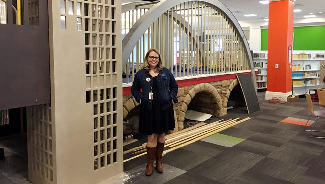Nashville Public Library children's librarian Lindsey Patrick shows off the new reading fort.