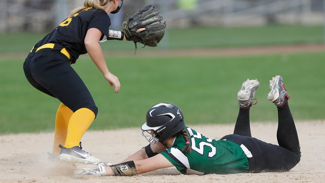Kewauskum High School softball's Kaitlyn Miller slides safe into second base as Waupun High School's Claire Harder catches the ball Tuesday, May 8, 2018 during their game in Waupun. Doug Raflik/USA TODAY NETWORK-Wisconsin