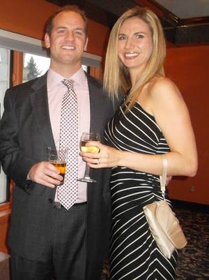 Eric Schillinger, a member of the regional board of directors at Easter Seals NY, and wife Melissa attend the organization's Ice Wine Gala in 2013.