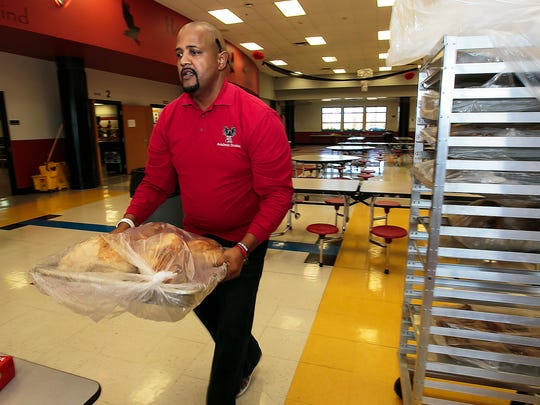 La Vergne Middle School Principal Cary Holman moves a tray of turkeys during a past community event called Project Feed that the school hosts annually. Rutherford County commissioners approved a $16.2 million expansion plan for the school as part of capital projects.