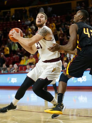 ASU center Eric Jacobsen puts a move on Bethune-Cookman center Ugo Okam during the first half at Wells Fargo Arena in Tempe November 17, 2014.