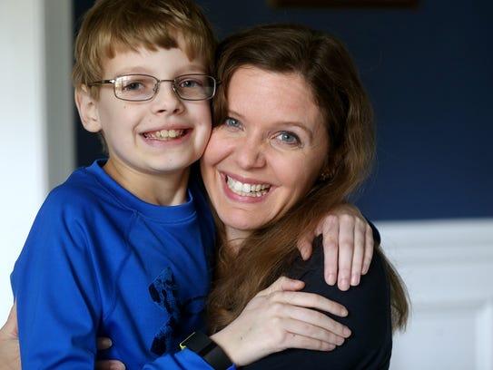 Honey Denson holds her son Luke, who has Shwachman-Diamond