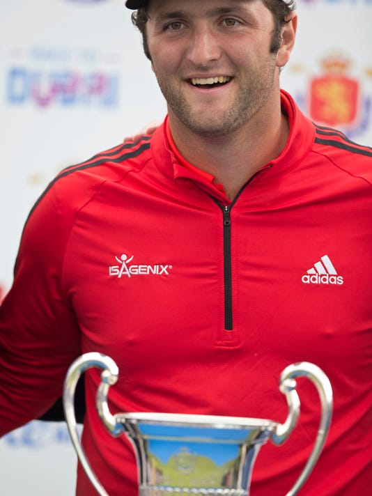 Spain's Jon Rahm poses with the trophy after winning the Spanish Open Golf tournament in Madrid, Spain, Sunday, April 15, 2018. (AP Photo/Paul White)