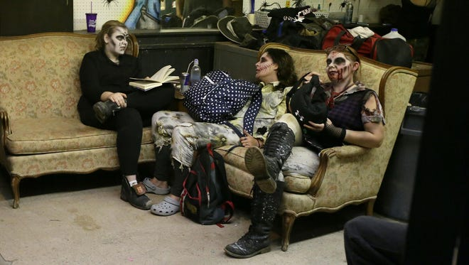 With makeup in place, performers wait backstage for the show to start at the Burial Chamber haunted house in Neenah. The haunted house opened in late September and continues on weekends through Nov. 4. Watch for Halloween guide updates at postcrescent.com.